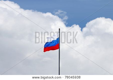 Evolving In Wind Flag Of Russian Federation On Background Of Large White Cloud