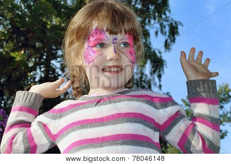 Happy Beautiful Little Girl With Pictured Purple Butterfly On Face Outdoor