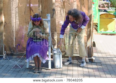 Perm, Russia - Jun, 23, 2014: Man And Woman With Cage At Show Of Perm Puppet Theater In Gorky Park