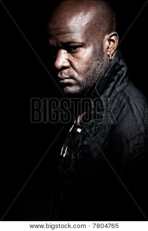 Black gangster Men Looking Serious On A Dark Background