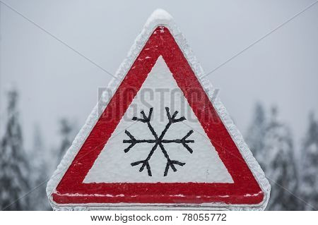 Traffic Sign For Icy Road Covered With Ice