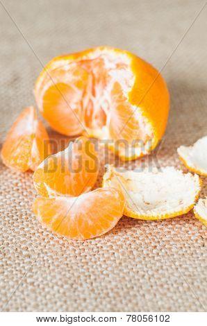 Orange Mandarin Or Tangerine Fruit On Burlap Background
