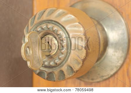 Closeup of key inside keyhole