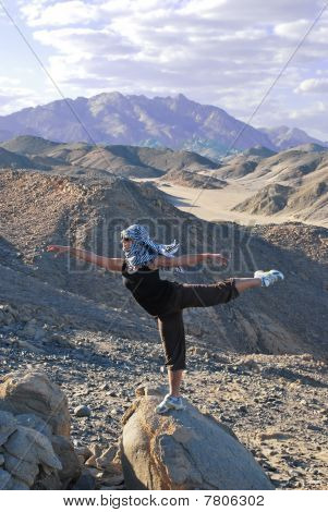 Girl Is Doing Horizontal Stand On The Big Stone