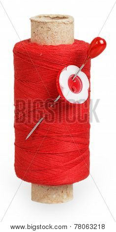 The Coil Of Red Thread With The Red Button On Pin