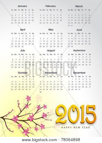 Annual calendar of 2015 with branch of pink flowers for Happy New Year celebrations.