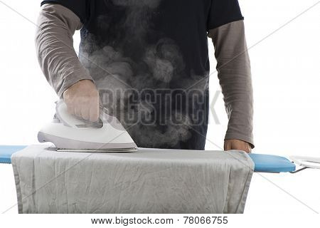 Close up hand of a man ironing clothes on ironing table.