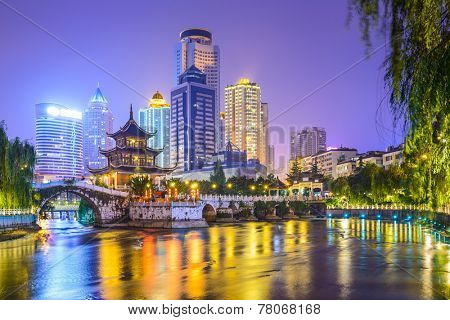 Guiyang, China city skyline on the Nanming River and Jiaxiu Pavilion.