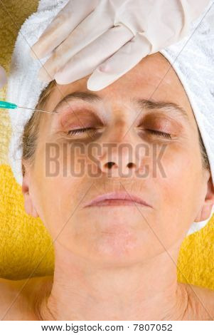 Senior Getting Injection In Eyebrow