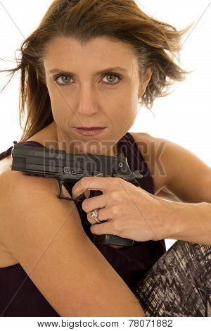 Woman In Tank Top Sit With Gun Hair Blown