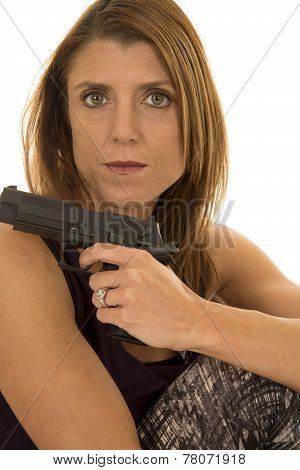 Woman In Tank Top Sit With Gun Look Serious