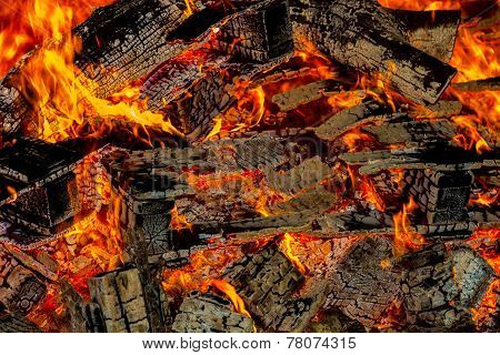 Embers from burning wood pallets