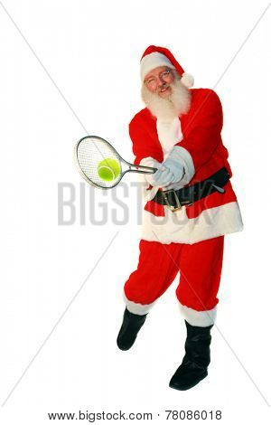 Santa Claus Plays Tennis. Focus on the Tennis Racket and Ball with Santa slightly out of focus. Isolated on white with room for your text. Santa Loves Sports and plays tennis with the elves daily.