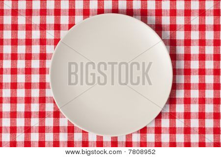 Plate On Checkered Table Cloth