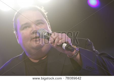 Homestead, FL - NOV 21, 2011:  Comedian, John Pinette, performs at the NASCAR Nationwide Series Champion Banquet at the Loews Hotel in Miami Beach, FL.