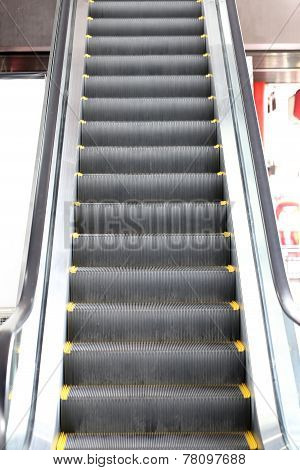 Escalator In The Shopping Mall.