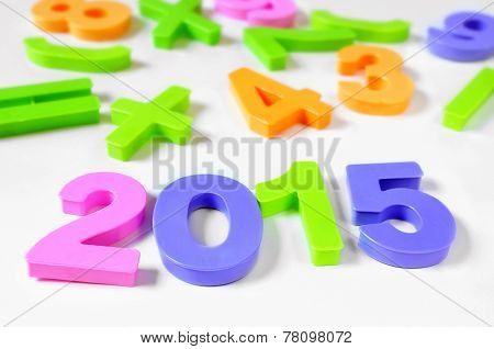 plastic numbers of different colors forming the number 2015, as the new year, on a white background