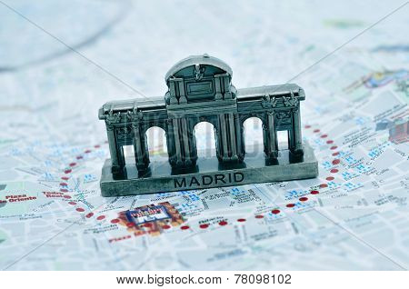 a miniature of the Puerta de Alcala on a map of Madrid, Spain
