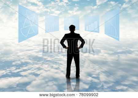 Businessman Standing Looking At Business Flowchart