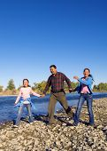 stock photo of mongolian  - Mongolian family anjoy walking by the river - JPG