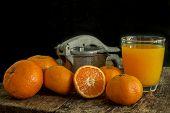 picture of juicer  - Still Life orange patterned on old wood and antique juicer - JPG