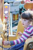 foto of pirate girl  - Beautiful little girl rides on carousel pirate ship in summer park - JPG