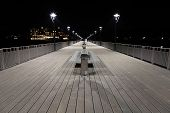 image of lamp post  - Night view of a boardwalk bench and lamp posts - JPG