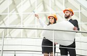 foto of male female  - Young male and female architect in the modern office. ** Note: Soft Focus at 100%, best at smaller sizes - JPG