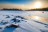 image of arctic landscape  - Midday sunset in polar landscape with ice fisher on thick ice - JPG