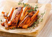 pic of batata  - sweet potato fries on wooden table . Selective focus