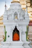 foto of yangon  - A Buddhist monk prays at Shwedagon Pagoda in Yangon Myanmar - JPG