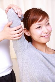 stock photo of chiropractic  - woman getting a chiropractic in the chiropractic office - JPG