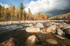 foto of loon  - Pemigewasset River and dark clouds over lower Loon Mountain - JPG