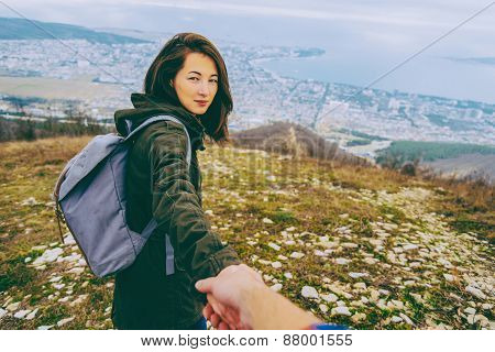 Traveler Young Woman Holding Man's Hand And Leading Him