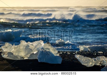 Blocks of ice from the glaciers break up and is washed ashore by the strong waves of the North Atlantic sea in Iceland.
