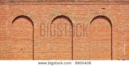 Three Brick Arches On Old Wall