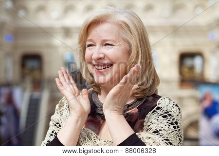 Close up facial portrait of a beautiful senior woman friendly smile and attentive expression