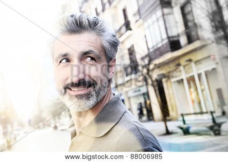 Handsome mature man standing in the street