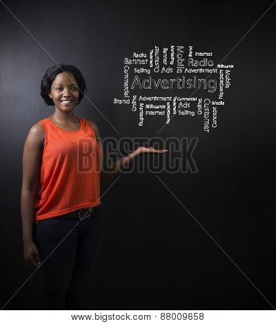 South African Or African American Woman Teacher Or Student Against Blackboard Advertising Diagram