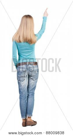 Back view of  pointing woman. beautiful blonde girl. Rear view people collection.  backside view of person.  Isolated over white background.