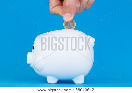 piggy bank and hand man throwing money