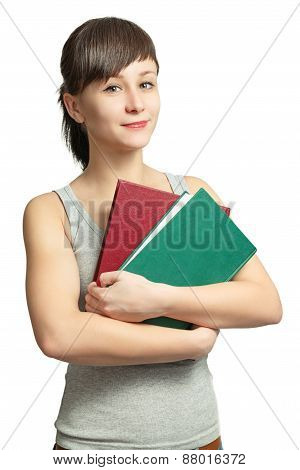 Portrait of a smiling girl with books on white background