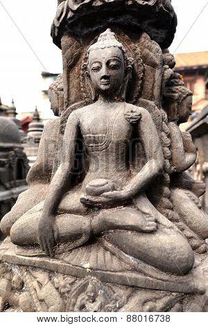Stone Statue Of Sitting Buddha In Swayambhunath. Nepal
