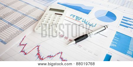 Calculator and business items on a desk