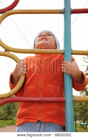 Boy On Climbing Staircase Looking Up