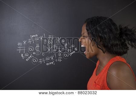 South African Or African American Woman Teacher Or Student Against Blackboard Swearing