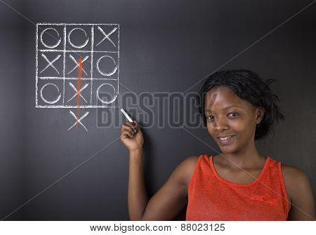 Thinking Out Of The Box African American Woman Teacher Or Student On Blackboard Back