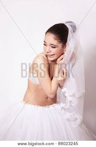 Portrait Of A Fun Bride In Veil