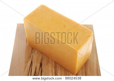 aged italian deli fresh cheddar cheese served on wooden cutting plate isolated over white background