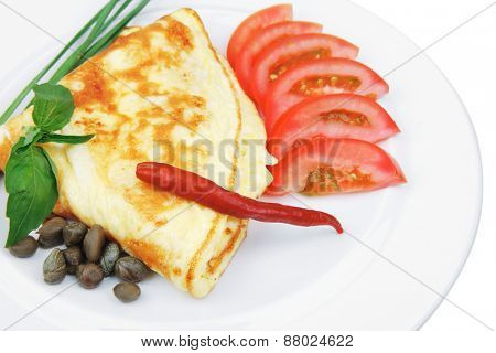 omelette with tomatoes and pepper served on white plate isolated on white background